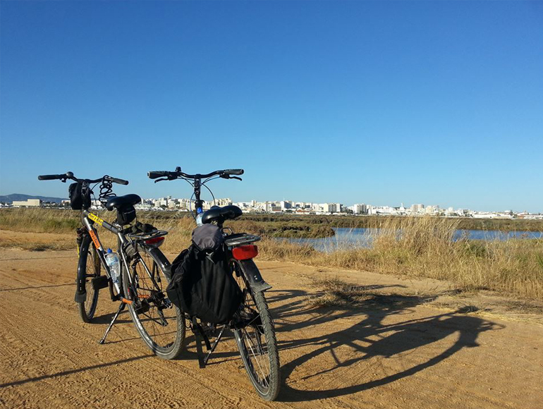 Bikes parking watching Faro: Holidays in Portugal Algarve | MegaSport Travel